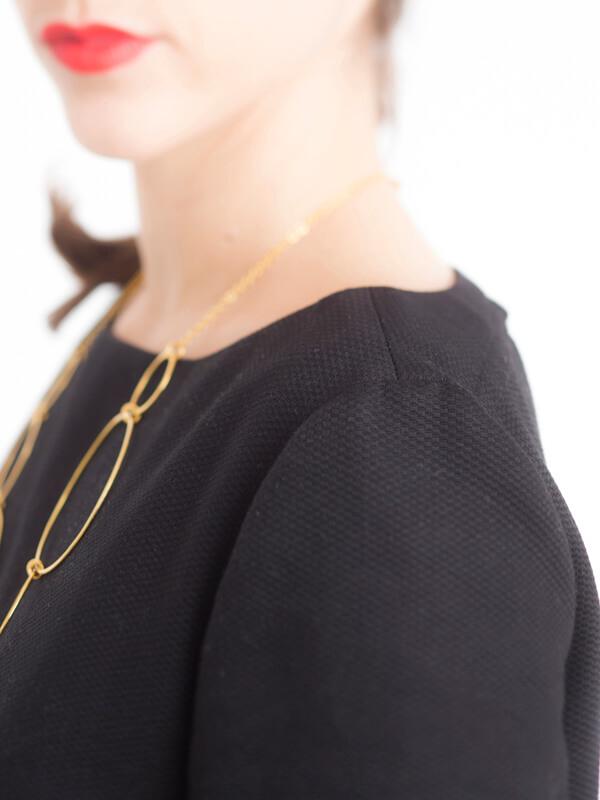 Detail of I AM Aphrodite - sewing pattern backless black dress shouder